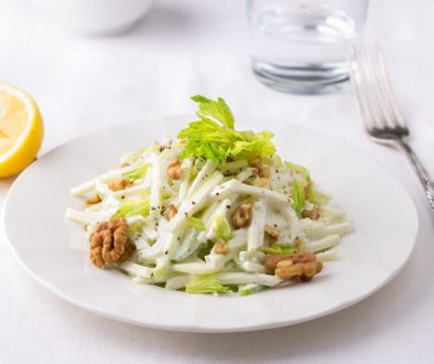 Traditional Waldorf salad with celery, apple, walnut and yoghurt dressing on white background, selective focus, horizontal